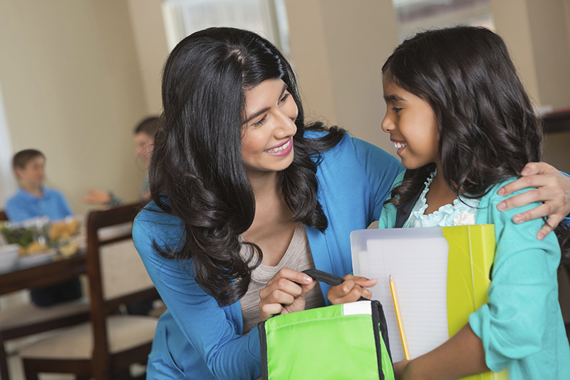 Photo of Mother Enrolling Child in School
