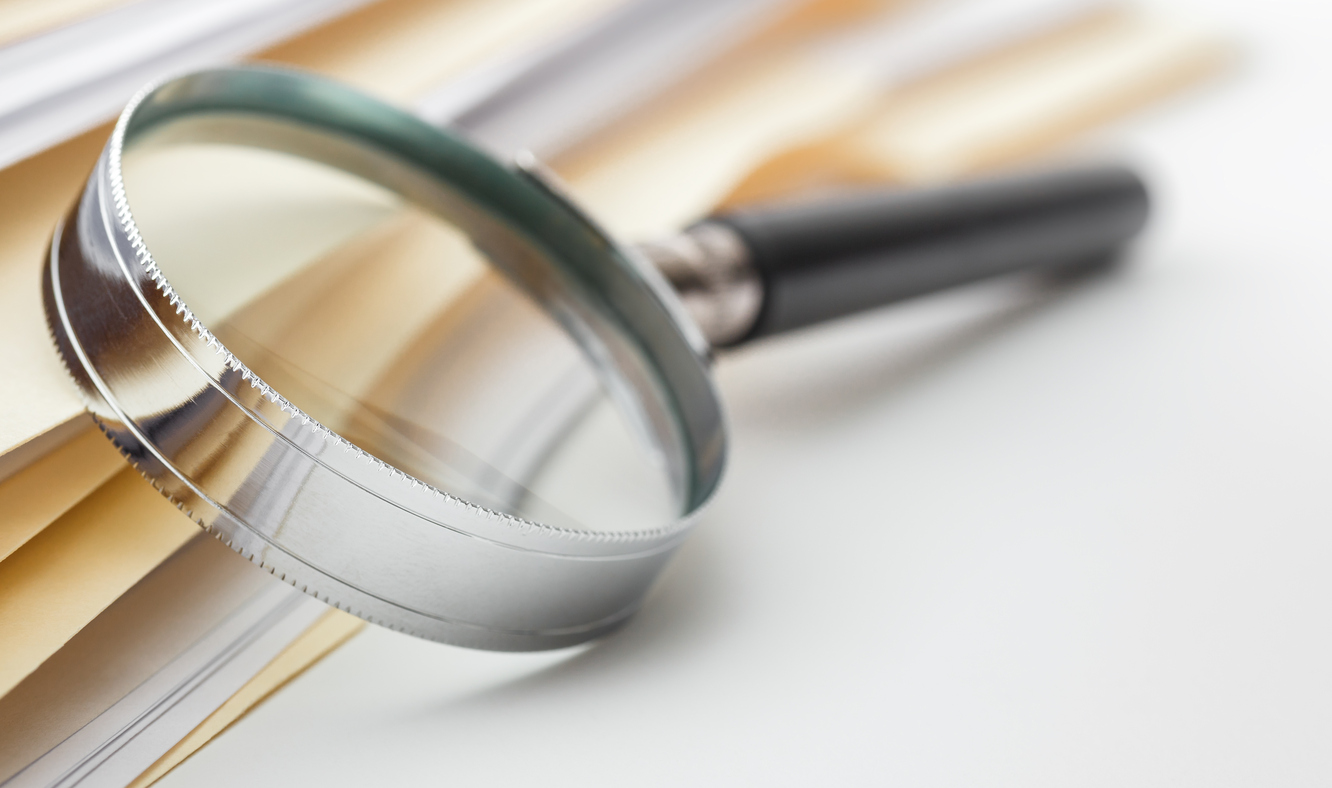 File Stack and Magnifying Glass