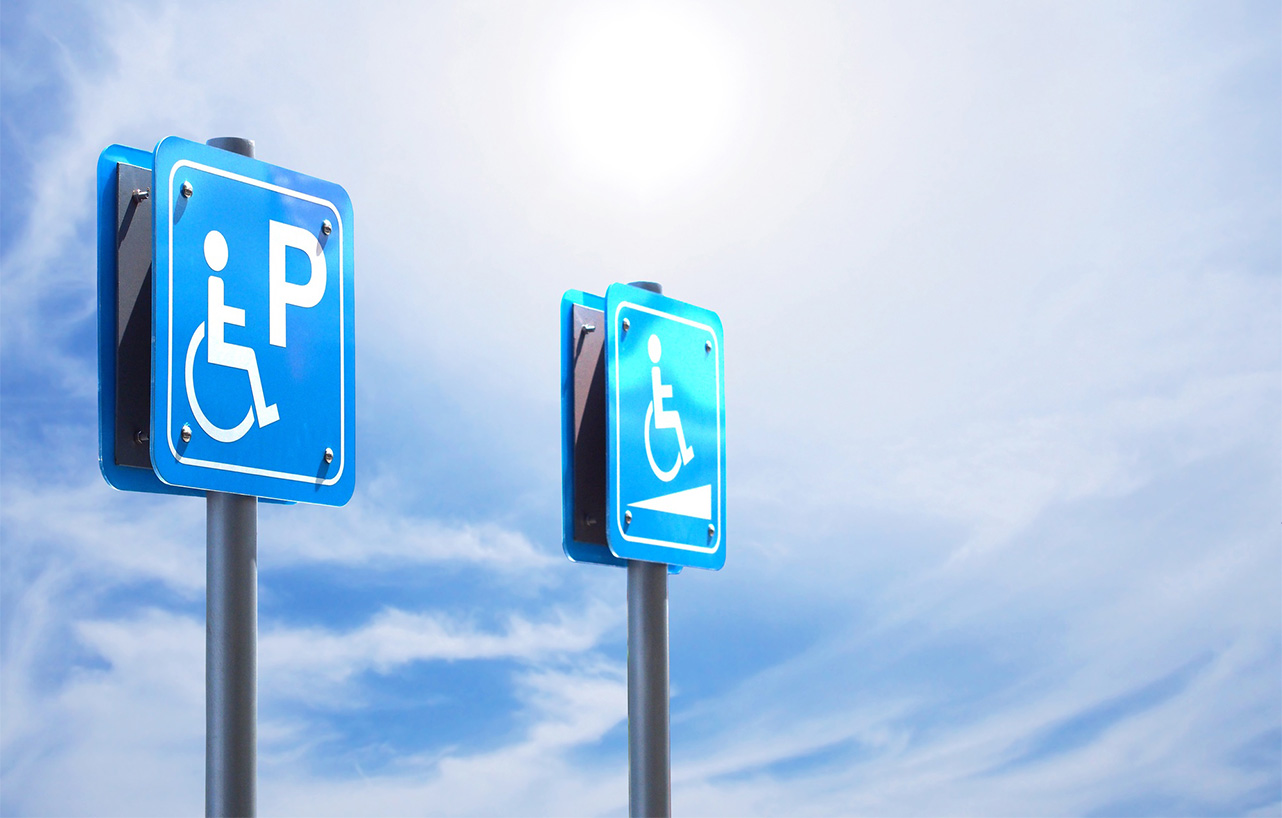 Handicapped parking and slope way sign