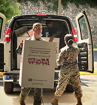 Marines unloading boxes for Toys for Tots